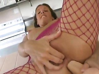 Busty MILF toying with the addition of fingering