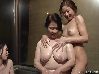 Hardcore lesbian fucking between a mature and a younger babe