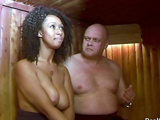 Ebony unspecified gets spanked in the sauna. White sponger spanking a black gal over the knee