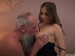 Old bearded guy has a ring with beautiful hell-hound Antonia Sainz