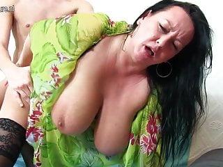 Big breasted mama fucking and sucking young boy