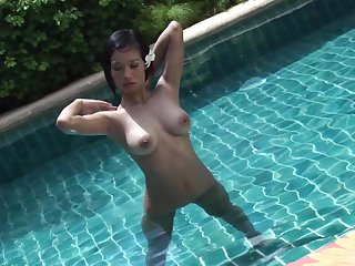 Busty Asian babe Nicha rides a big hard white cock outdoors