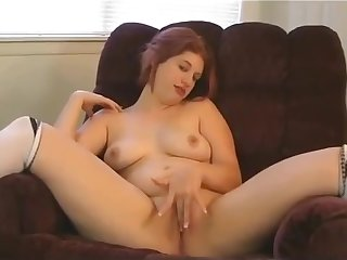 Amatory chubby redhead showing ass and bosoms on cam