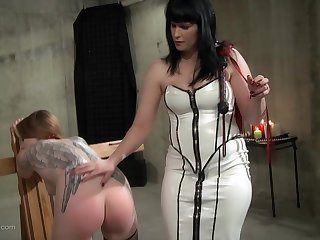 Tattooed slut is bent over and spanked by her mistress