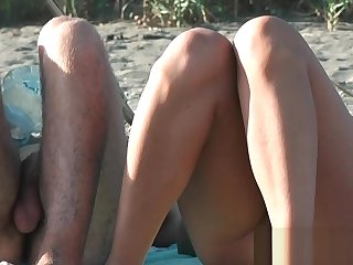 An excellent spy cam unconcealed beach voyeur video