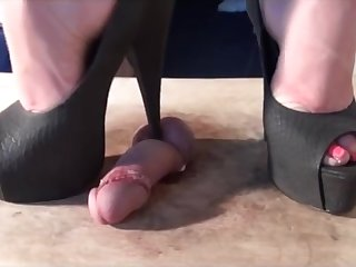 Attractive brunette squashes a thick white horseshit with her lofty rotter shoes