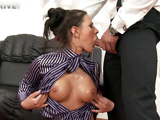 Clothed glamour model Athina on her knees sucking a fat cock