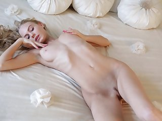 Smokin' hot blonde Nancy A in a white lingerie plays with her tits