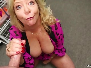 Karen Summer undresses near jot her boobs and strokes a cock