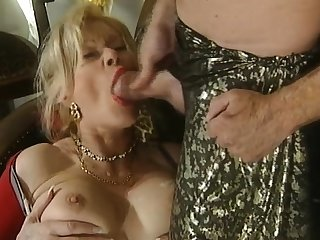 Great blowjob from the mature busty blonde
