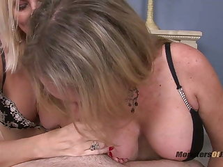Two Big Tit Milfs Suck Cock POV
